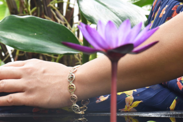 A woman wearing the tri-color Peace Crane Jewelry bracelet.
